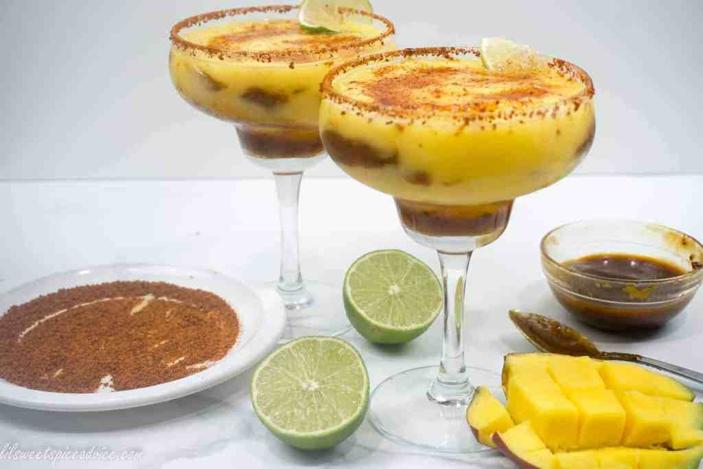Mangonada Margaritas--Mangonada and margaritas have finally joined together in holy matrimony! Homemade organic chamoy sauce, frozen mangoes, and chili lime seasoning are combined to make a twist on the classic frozen margarita.--lilsweetspiceadvice.com