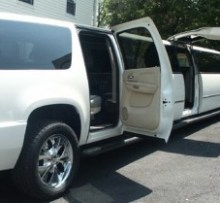side view of cadillac escalade limo super stretch 18 pass photo
