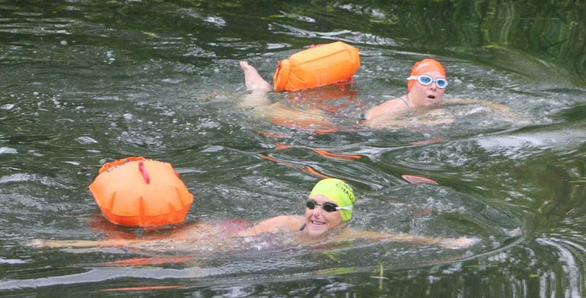 Deaf news women swim 22 miles to raise money for deaf for Swimming chicken