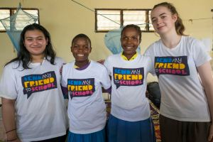 Samina and Jessica with two residents of Kinanga School for the Deaf, Kenya.