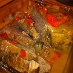 Slow cooker roast with bell peppers.