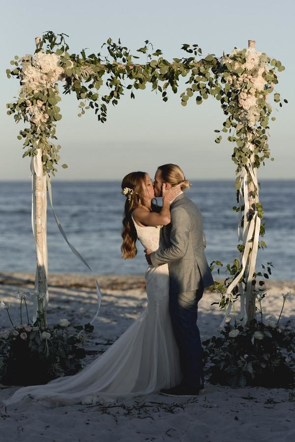 boho-chic-beach-wedding-A-Chair-Affair-vows-600x510@2x
