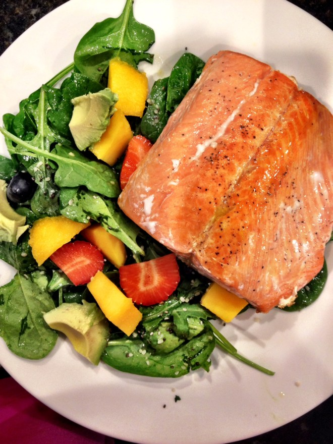 Wild caught, fresh salmon. Spinach salad with blueberries, strawberries, mango, avocado and a citrus dressing. Yum.