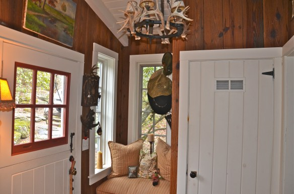 Step inside the welcoming entry–small seat and closet on this side