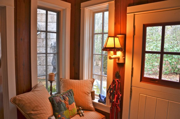 Cozy window seat and sconce–perfect for taking your boots off in the Winter chill