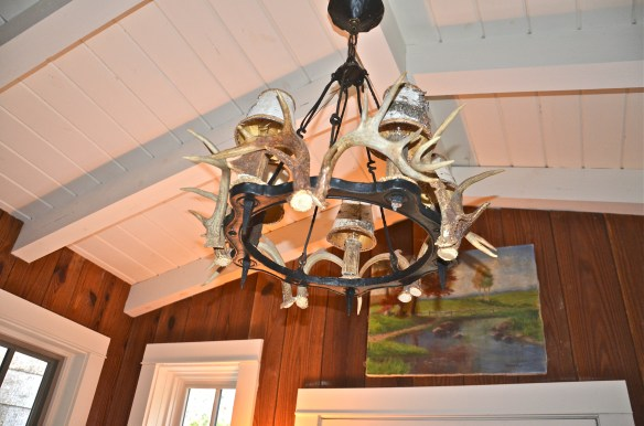 Check out the Antler chandelier with bark shades
