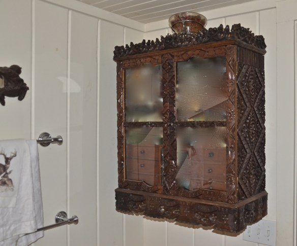 This Black Forest chest is used for bathroom storage–Great idea to add instant charm to a simple bathroom