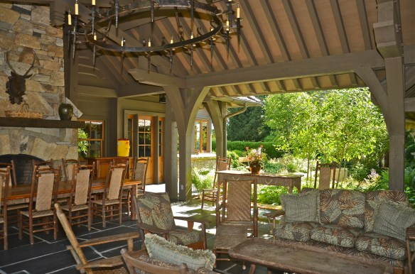 Ceiling beams, stone walls rustic furniture and oh-that chandelier