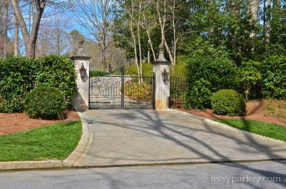 Cobblestone drive surrounded by boxwood