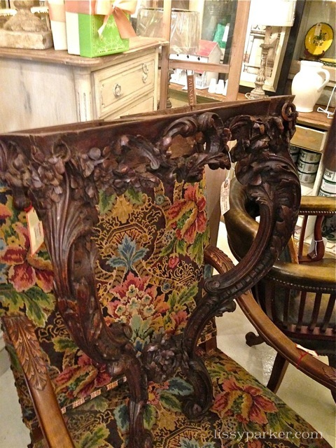 Needlepoint chairs and carved tables with marble tops