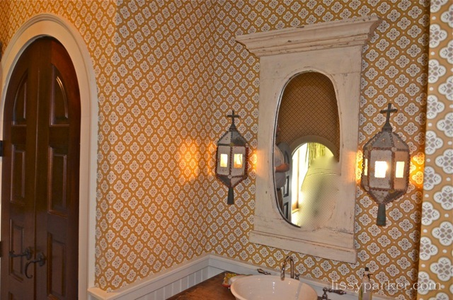 I love these sconces in the guest room upstairs—click on the link for more pictures of charming house