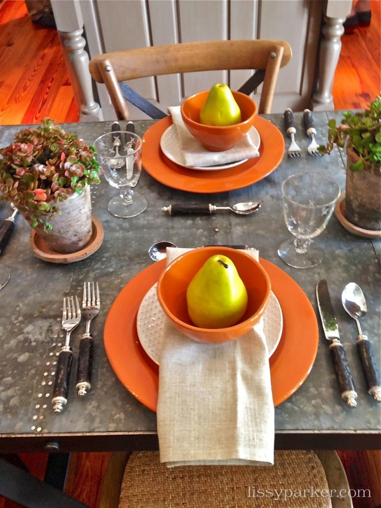 Table setting featured beautiful touches of orange