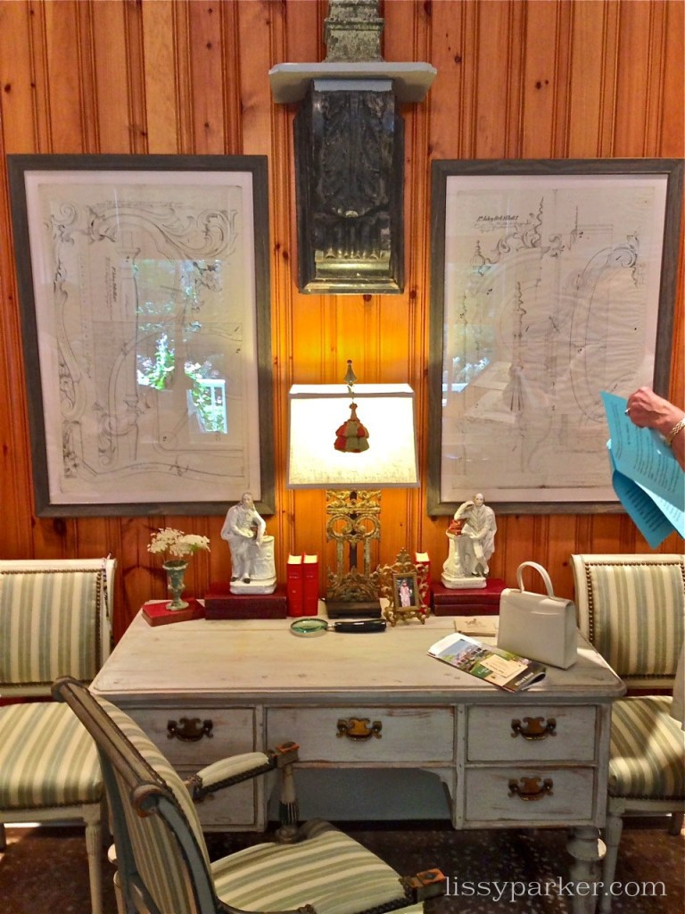Charming desk and maps are featured in the study