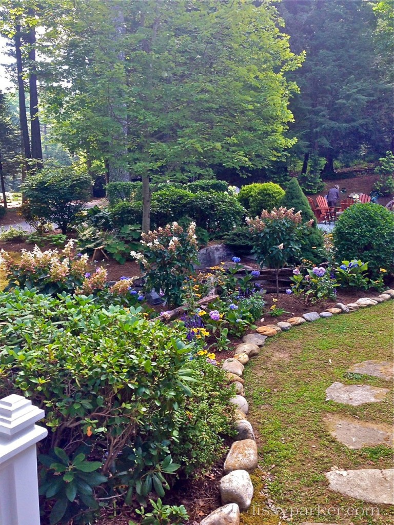 Charming garden and path lead to the small lake