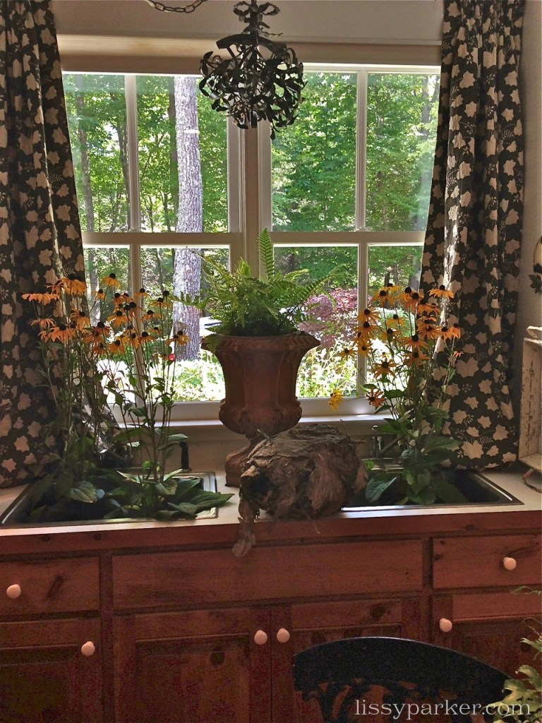 Deep double sinks in the mudroom/flower room look out over the garden