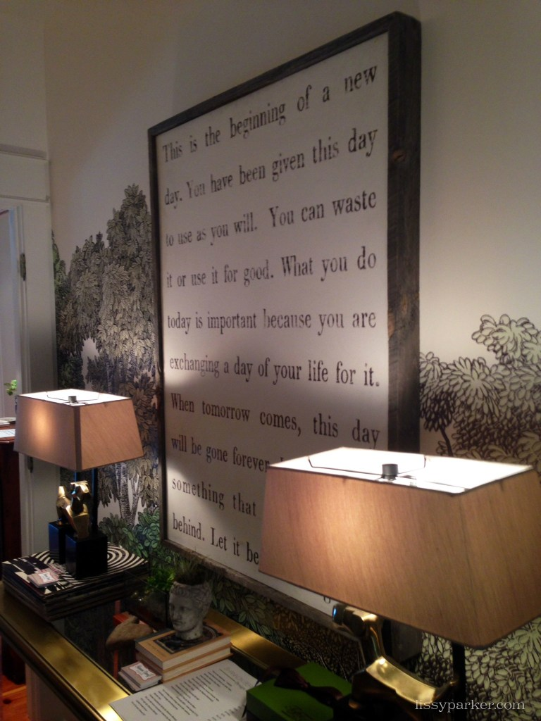 Scenic wallpaper covers this entire charming room