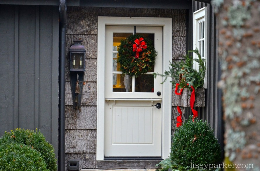Magnolia wreath decorates the kitchen Dutch door