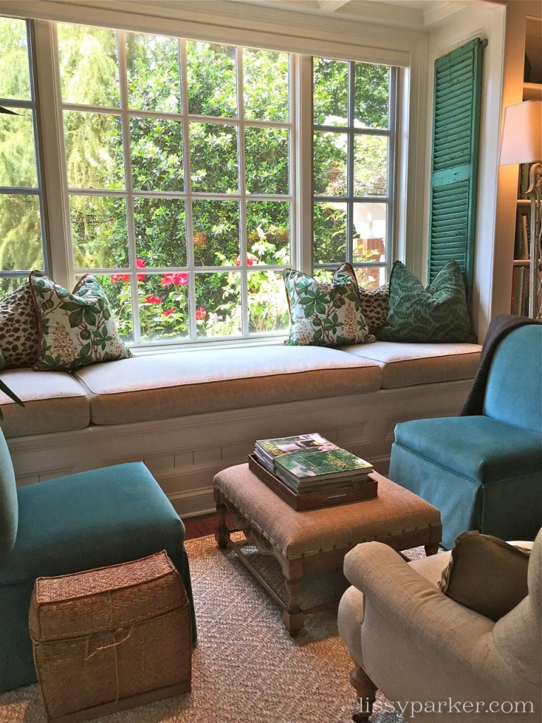 Opposite the fireplace is an inviting window seat overlooking the garden and pool.