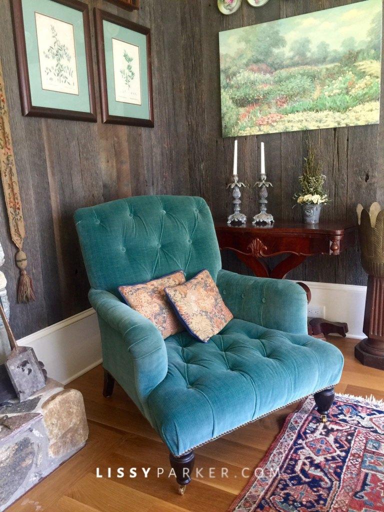 Custom velvet chair draws you into the barn wood living room