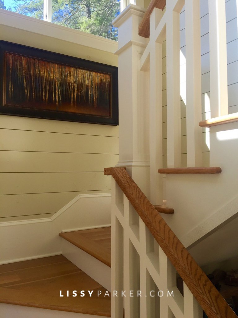 Beautifully milled staircase leads to Family gathering room