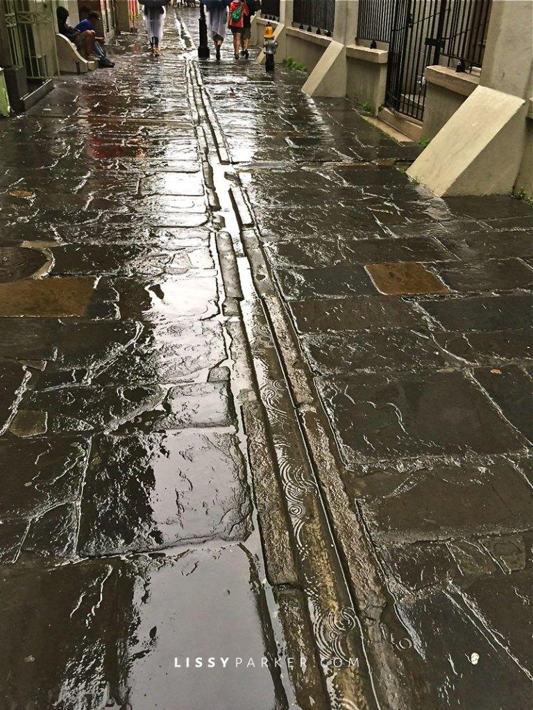 cobblestone drains in the sidewalks