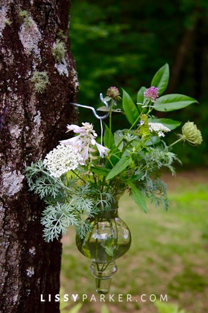 flower vase attached to a tree