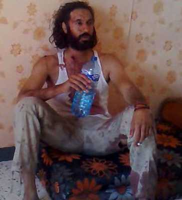 Mutassim-Gaddafi-Takes-A-Sip-Of-Water-Before-His-Death-In-Sirte-Pic-Afp-Getty-Images-696065127