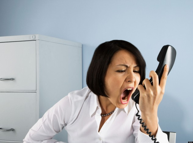 Businesswoman shouting at telephone. Image shot 2008. Exact date unknown.