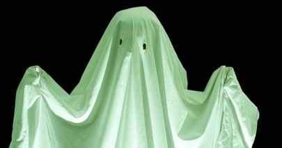 fancy dress ghost lit with spooky green light from below