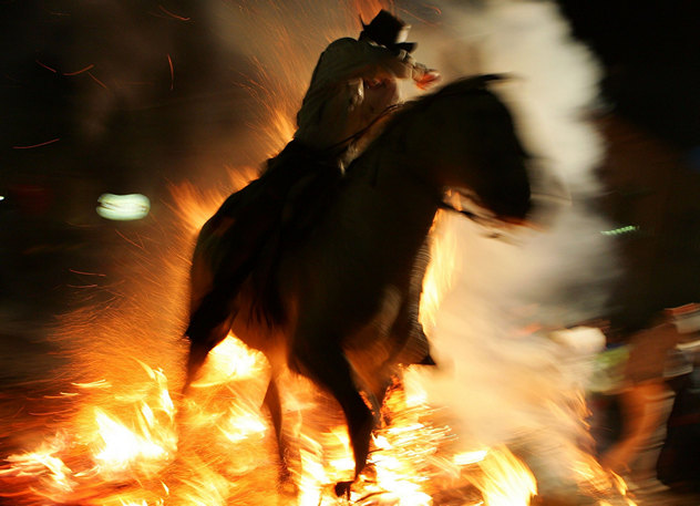 Spanish Horsemen Leap Bonfires To Celebrate Feast Of St Anton