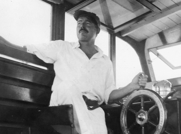747px-Ernest_Hemingway_and_Carlos_Gutierrez_aboard_Pilar,_Key_West,_1934