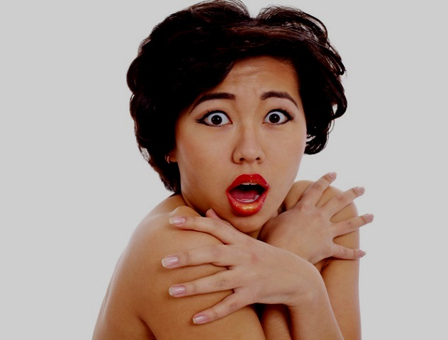 Shocked asian young woman closeup