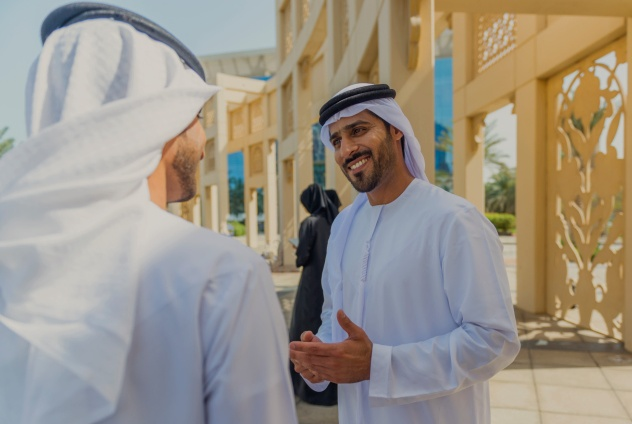 Two Emarati Business people talking outside the office.