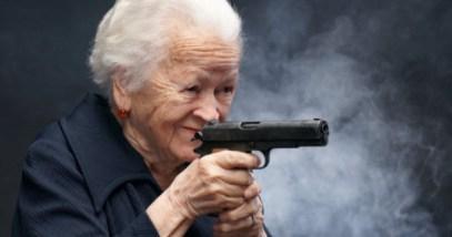feature-old-woman-firing-gun-462530795