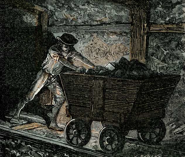 Victorian coal miner pushing a minecart