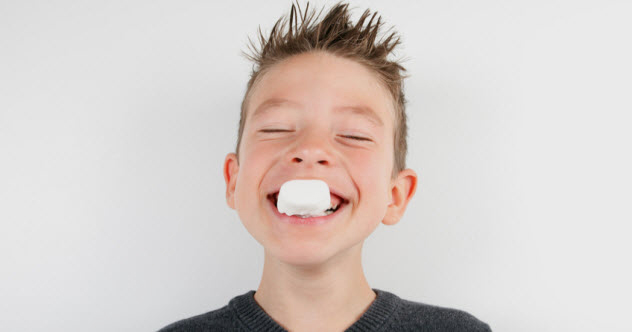 6a-boy-eating-marshmallow_22222484_SMALL