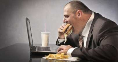feature-c-9a-obese-man-using-computer-155511848