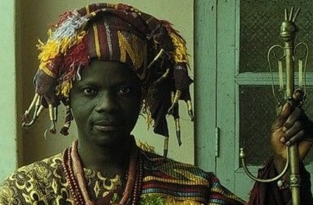 Adesina Adeyemi, from Ijebu-Ife, is dressed in his typical attire as head of the reformed oshugbo fraternity.