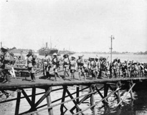 Nigerian Brigade soldiers-disembarking at Lindi, German East Africa in December 1917.