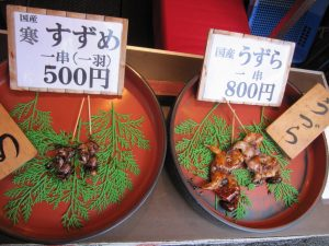 spparows and quails on a stick, outside of kyoto