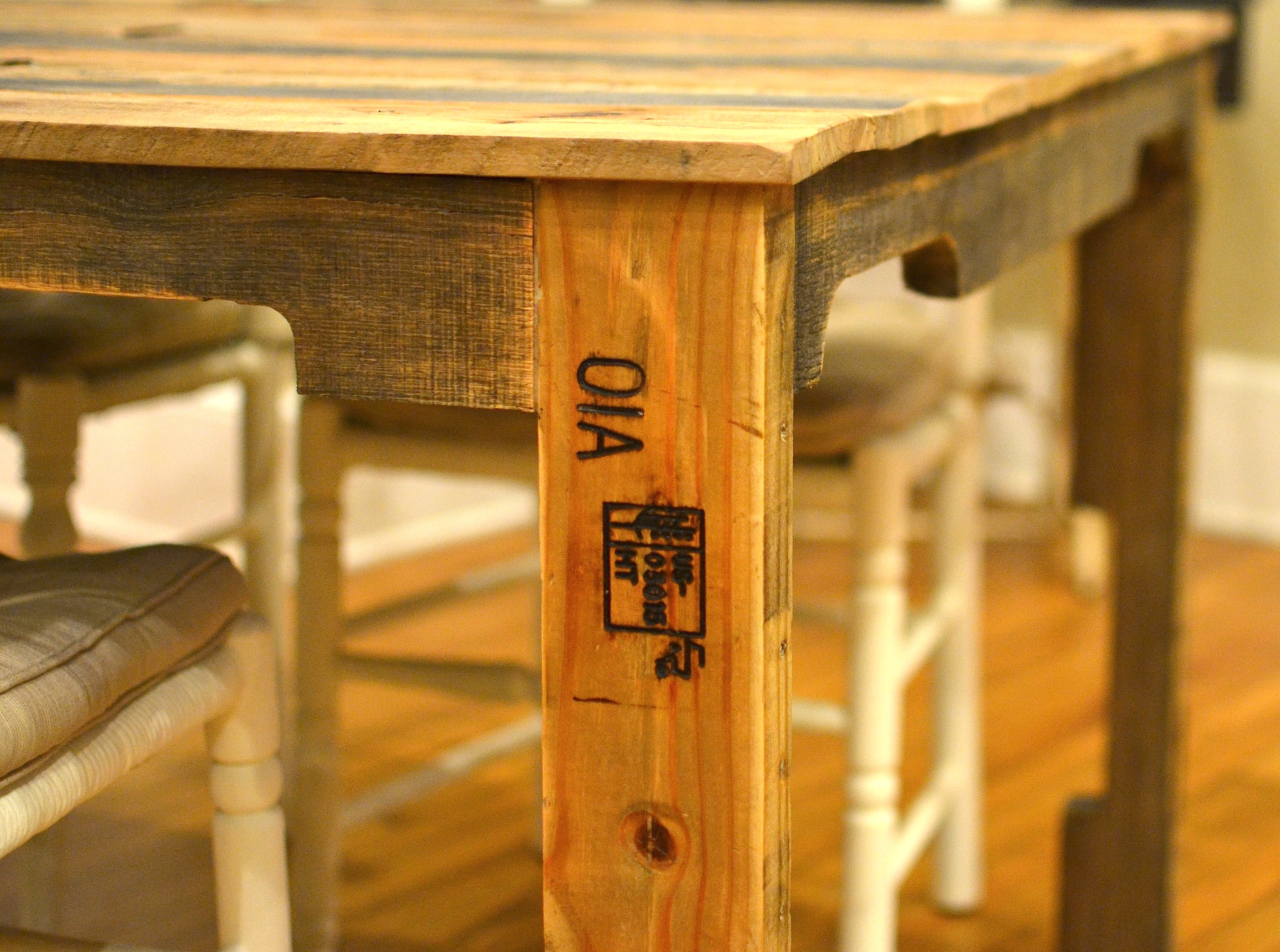 the shipping pallet dining table diy kitchen table plans Stamped boards from shipping pallets feature prominently in the dining table design