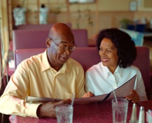 African American Couple Reading Menu