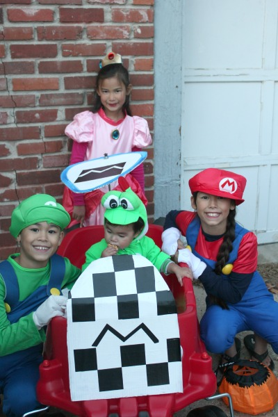 We turned it into a Mario Kart to go along with our Mario Brou0027s themed Trick or Treating extravaganza!  sc 1 st  Living Chic Mom & Little Tikes Cozy Coupe Wagon - DIY Mario Kart! - Living Chic Mom