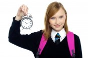 school girl with alarm clock 300x200