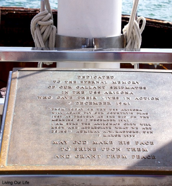 The plaque to the sailors that are forever stationed with the USS Arizona
