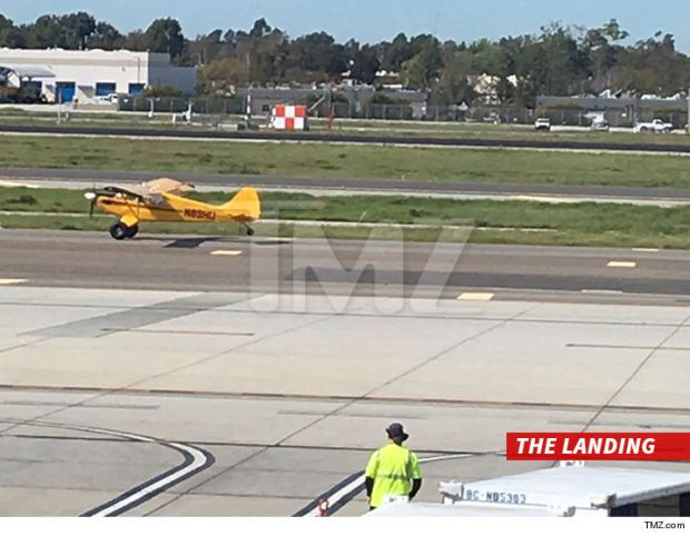 0216-harrison-ford-landing-tmz-02