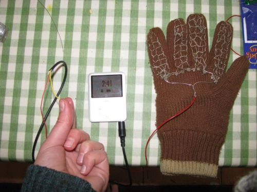 One glove connected to an iPod (yellow wire is ground that is connected to skin)
