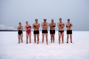 Brighton swimming club members posing in the snow