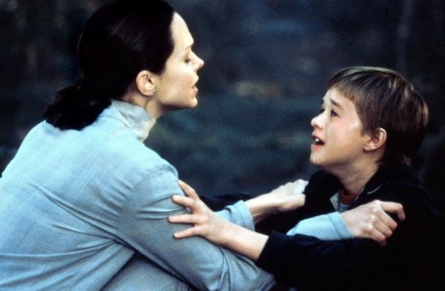 "Left, Monica (Frances O'Connor) struggles with robot son David (Haley Joel Osment) in the Spielberg-Kubrick collaboration ""A.I. Artificial Intelligence."" Here, Monica is abandoning David deep in the woods, because his profound love for her (she fears) endangers her human family, but she fears also he'll be destroyed by his makers."