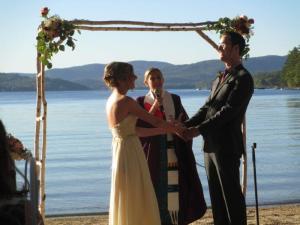 Kim and Jason at the altar, on the beach at Newfound Lake, NH